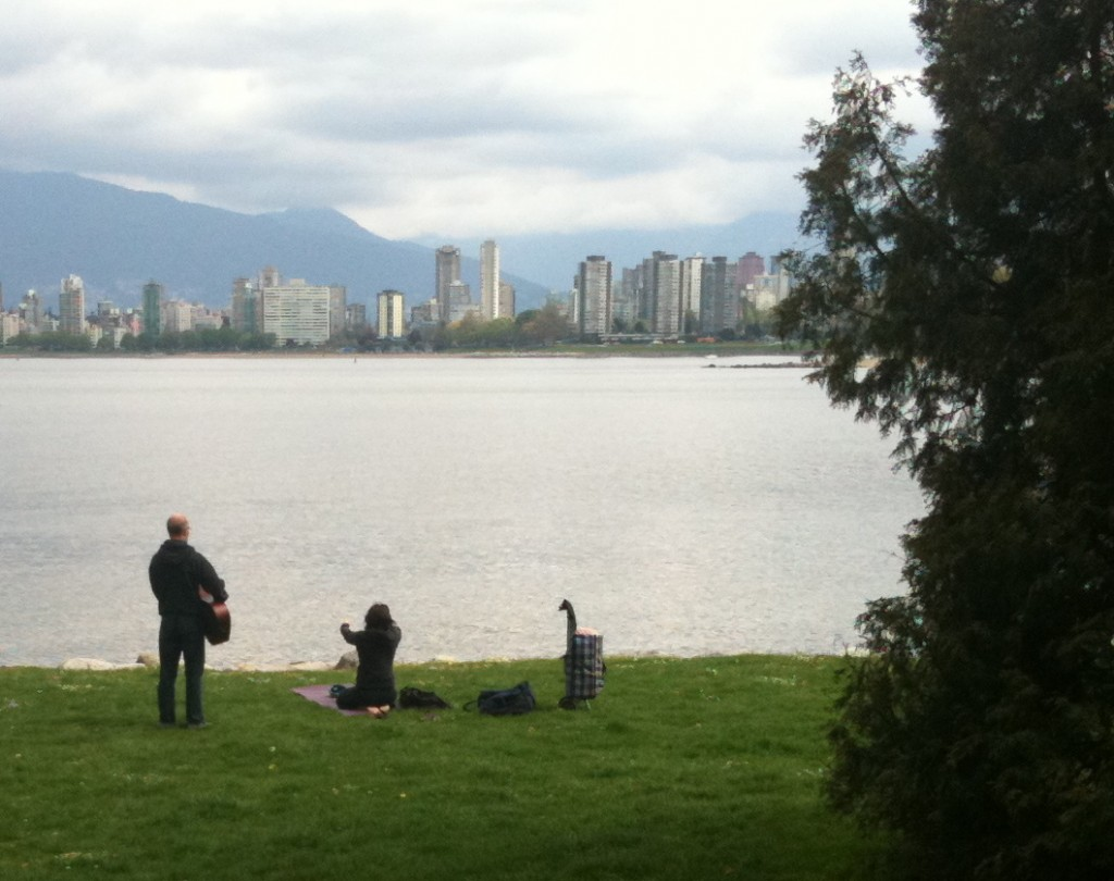 Outdoor yoga with guitar at Kits beach