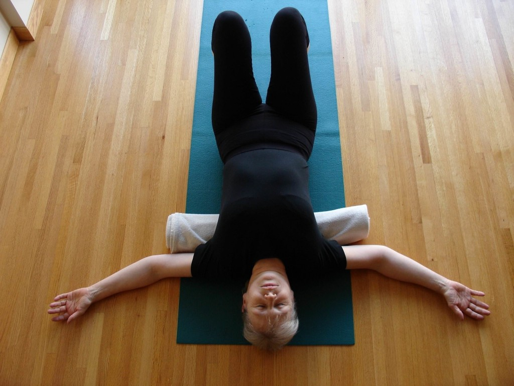 Check that your shoulders are being tugged away from your ears and your lower back is long before you straighten your legs.