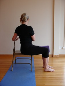 Using a chair helps you find a straight spine in your twist.