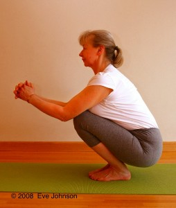 Squat on your heels. If they don't reach the floor, use a chip-foam block or a book to support them.