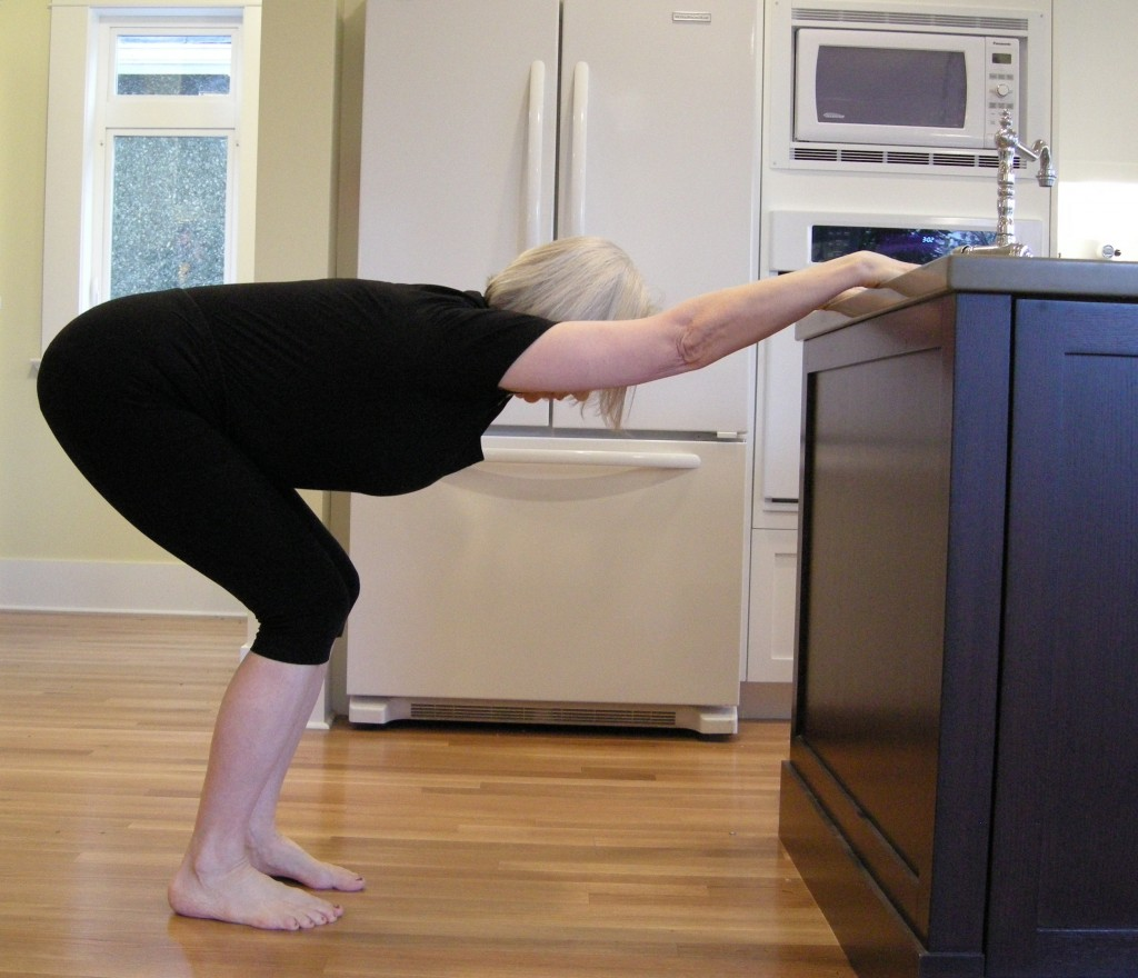 Bend your knees as deeply as you can and stretch through your armpits.