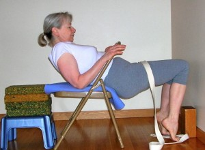Bring your buttocks over the edge of the chair toward the wall, then slide back.
