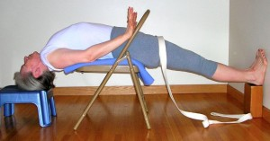 Use your hands on the chair back to help connect with your shoulder blades