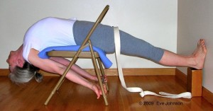 Hold the back of the chair seat to increase the stretch across your chest.