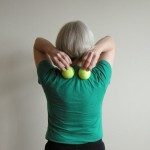 Five-minute yoga challenge: roll your upper back on tennis balls