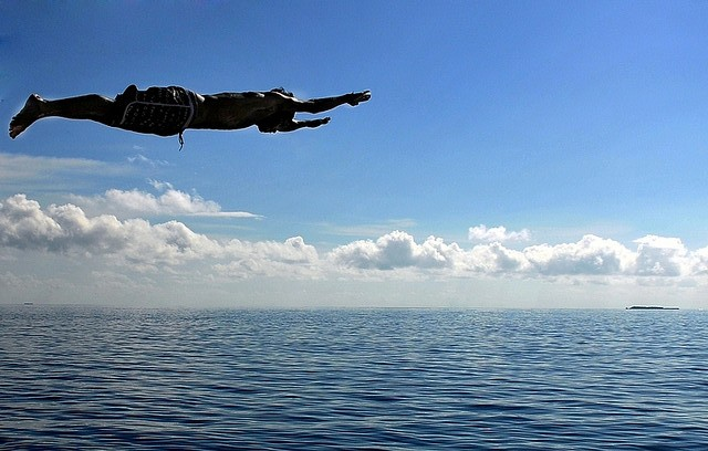 boy in flight over water