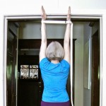 Five-Minute Yoga Challenge: stretch your arms in a doorway