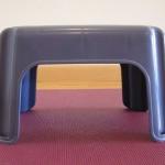 Shoulder stand preparation on a little plastic stool: Five-minute Yoga Challenge