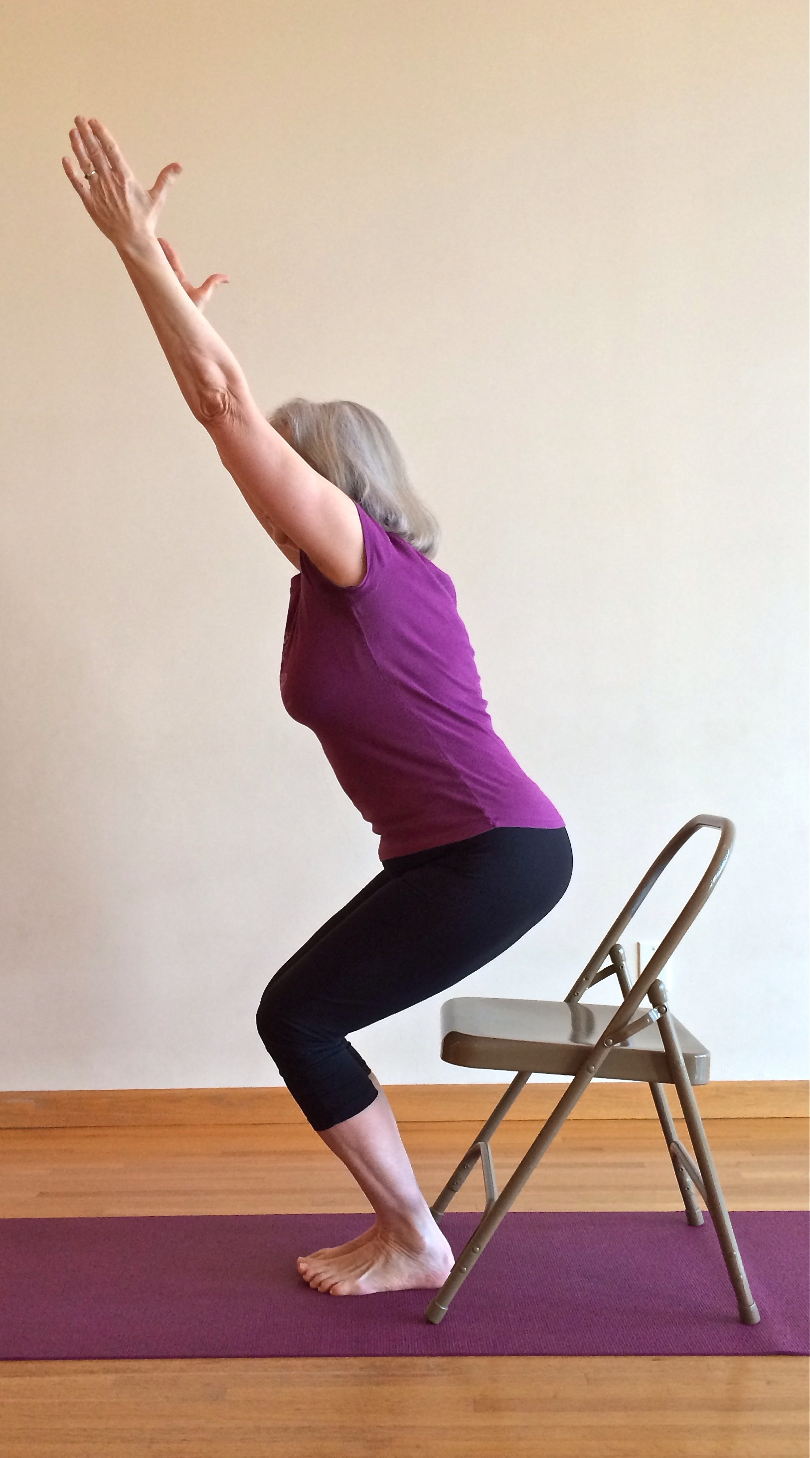 Take a seat in Utkatasana the yoga chair Five Minute Yoga Challenge