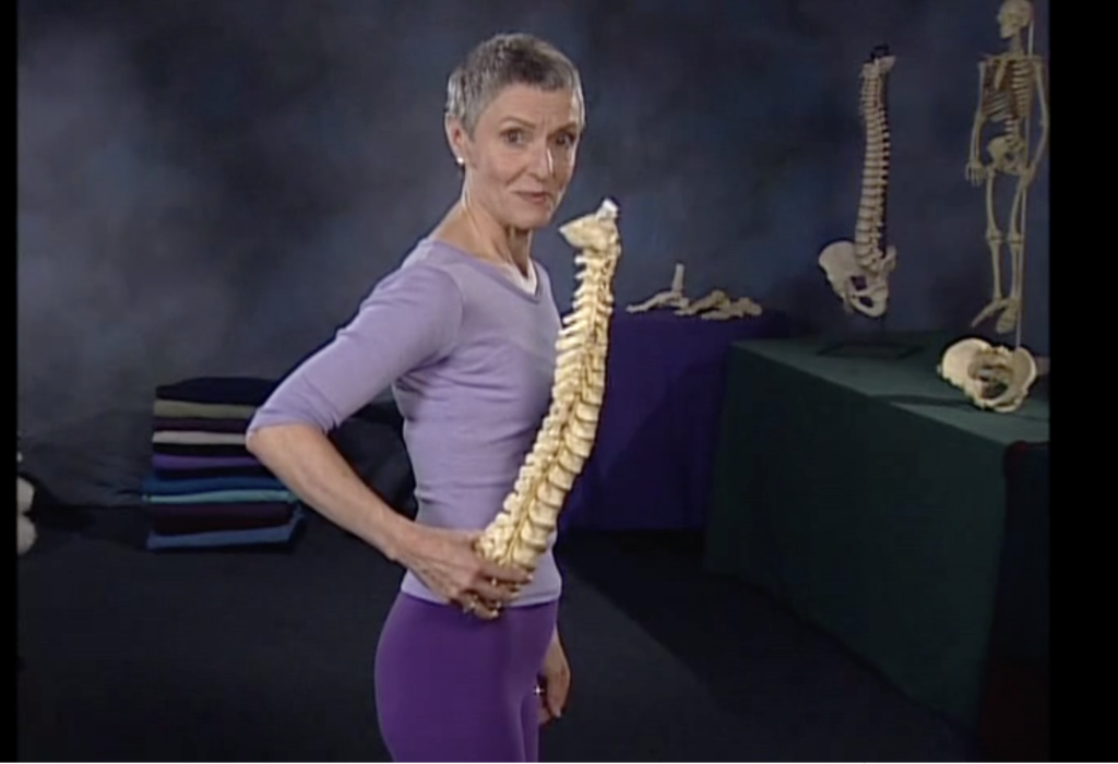 Jean Couch holding a spine